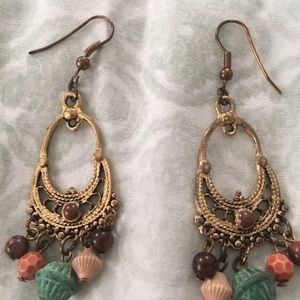 Gold tone dangle earrings with beads